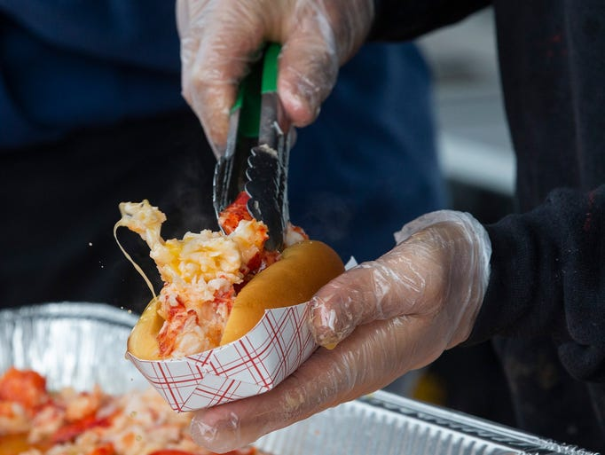 A Lobster Roll being made at Point Lobster booth at