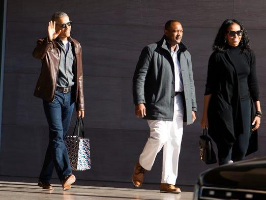 Former President Barack Obama accompanied by former