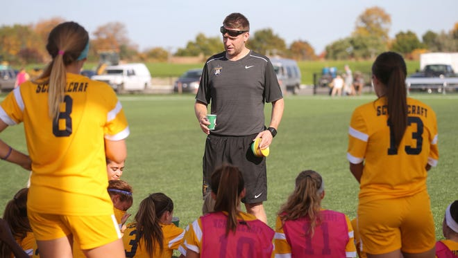 Schoolcraft College women's soccer coach Dave Carver talks to players Friday about the challenges awaiting them next week at nationals.