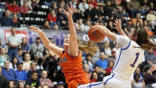 Silverton's Maggie Roth and La Salle's Aleah Goodman collide as the Foxes fall to La Salle 42-28 in the OSAA Class 5A state championship on Friday, March 10, 2017, at Gill Coliseum in Corvallis.