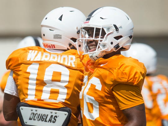 From left Tennessee defensive back Nigel Warrior (18) and Tennessee defensive back Terrell Bailey (26) run to a drill during a University of Tennessee fall football practice at Anderson Training Facility in Knoxville, Tenn. on Tuesday, Aug. 15, 2017.