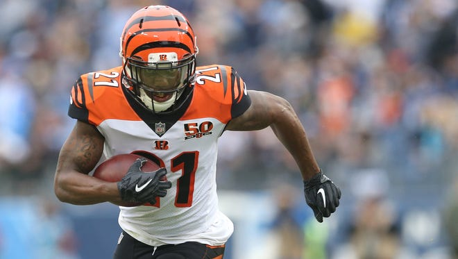 Cincinnati Bengals cornerback Darqueze Dennard (21) runs back an intercepted pass in the second quarter during the Week 10 NFL game between the Cincinnati Bengals and the Tennessee Titans, Sunday, Nov. 12, 2017, at Nissan Stadium in Nashville, Tennessee.
