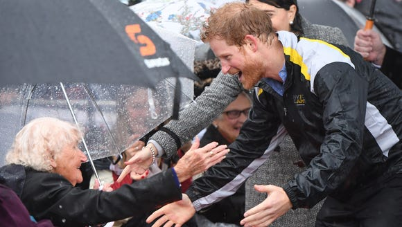 Prince Harry reunited with war widow Daphne Dunne while