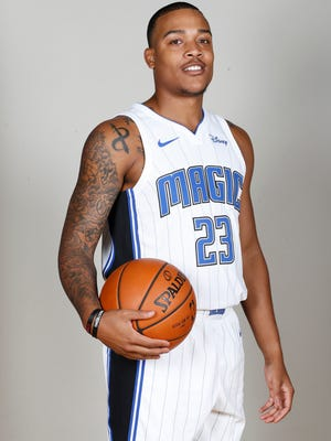 Orlando Magic guard Troy Caupain (23) poses for a photo during Media Day at Amway Center.