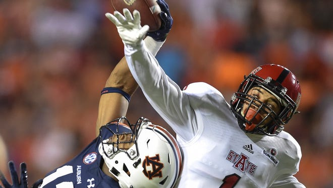 Auburn wide receiver Kyle Davis (11) pulls in a 42-yard pass while defended by Arkansas State defensive back Blaise Taylor (1) during the first quarter of an NCAA college football game Saturday, Sept. 10, 2016, in Auburn, Ala. (Julie Bennett/AL.com via AP)