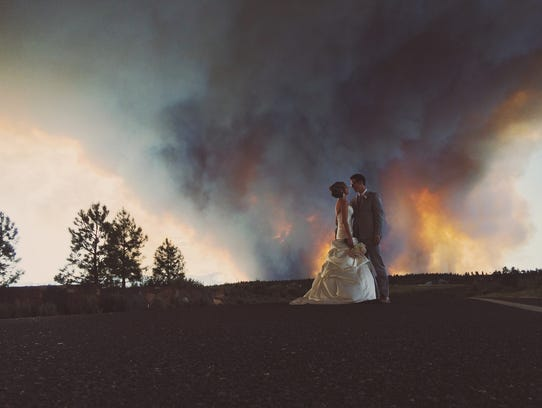 Wedding photos with wildfire raging go viral