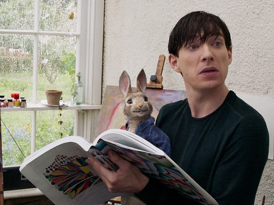 """Peter Rabbit (James Corden) with Mr. McGregor (Domhnall Gleeson) in Columbia Pictures' """"Peter Rabbit."""" The movie opens Friday at Frank Theatres Queensgate Stadium 13 and R/C Hanover Movies."""