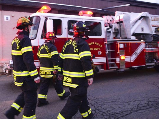 In this Dec. 7, 2017 photo, Beaver Falls firefighters return to their fire house after a false alarm in Beaver Falls, Pa. The firefighters often get called out on medical emergencies, such as drug overdoses. (Lucy Schaly/Beaver County Times via AP)