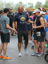 Former New York Yankees closer Mariano Rivera greets runners at a 5K last year in Garnet Valley, Pennsylvania. The event moves to Wilmington next month.