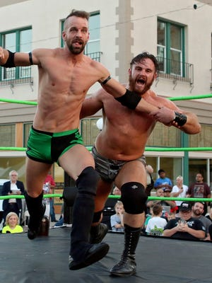 Moonshine Mantell (right) whips Double D into the corner during Wrestling Under the Stars in 2016. The outdoor wrestling event returns to town as part of the Professional Wrestling Hall of Fame and Museum's Induction weekend. It will start at 7 p.m. May 19 near the Downtown Farmers Market, Eighth and Ohio.