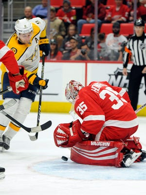 Red Wings goaltender Jimmy Howard (35) stops the shot of Predators left wing Filip Forsberg (9) in the first period on Tuesday, Feb. 20, 2018, at Little Caesars Arena.