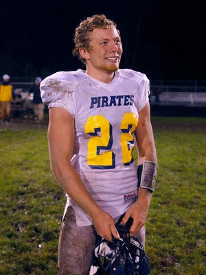 Pewamo-Westphalia's Jared Smith smiles following a 40-7 win over Laingsburg Friday, Sept. 30, 2016, in Laingsburg, Mich.