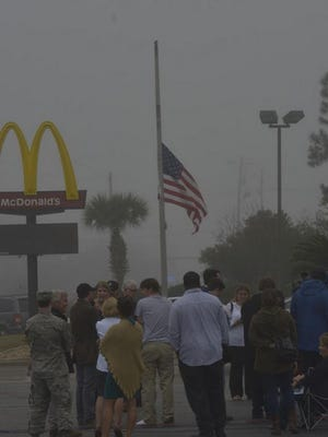 A flag at McDonald's in Navarre flies at half-staff in memory of the servicemen who were in the Black Hawk that went down in Santa Rosa Sound.