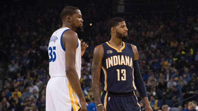 Golden State Warriors forward Kevin Durant and Indiana Pacers forward Paul George during the first quarter at Oracle Arena.
