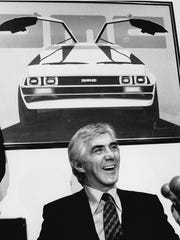 "John DeLorean answers reporters' questions at a news conference in New York on Feb. 19, 1982. DeLorean developed the short-lived gull-winged sports cars featured as a souped-up time travel machine in the ""Back to the Future"" movies."