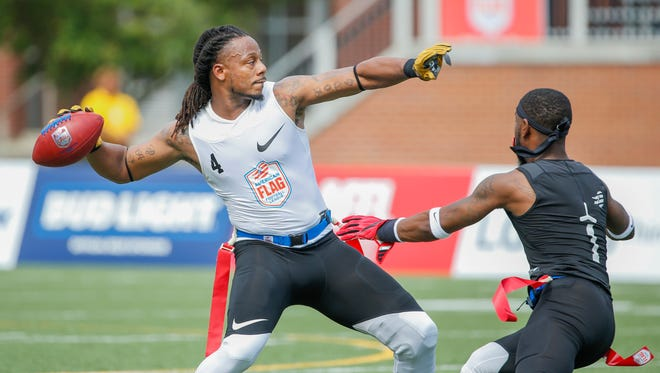 Fighting Cancer's Darius Davis (4) attempts to throw the ball to his teammate as The Money Team's Brandel Webb (1) pulls his flag during the Fighting Cancer vs The Money Team American Flag Football League game at Bud and Jackie Sellick Bowl on Saturday, July 14, 2018. The US Open of Football, a multimillion-dollar single-elimination tournament, began with 132 teams back in March. Only two pro teams and two amateur teams are still alive. The winners of these games will face off in Houston on July 19, as the top pro team and top amateur play in the winner-take-all $1,000,000 Ultimate Final on NFL Network.
