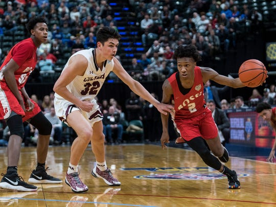 Bosse's Mekhi Lairy (2) drives past Culver Academies defenseman Trey Galloway (32) during the IHSAA Class 3A State Championship at Bankers Life Fieldhouse. The senior point guard is a finalist for the Indiana Mr. Basketball Award.