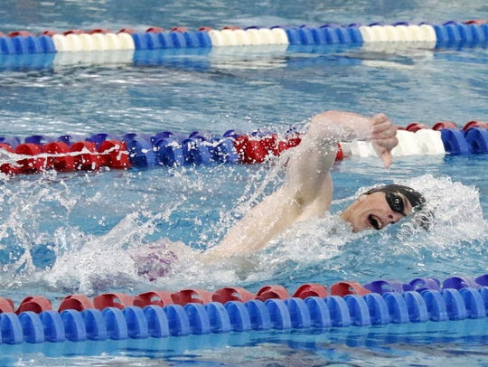 Jamie Lovette of Ithaca swims to victory in the 500-yard