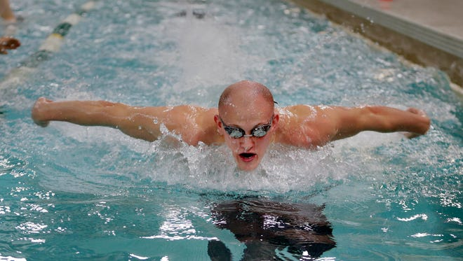 Danny Larson, a senior at Wauwatosa West who will attend Pacific this fall, works Wednesday during swimming practice.