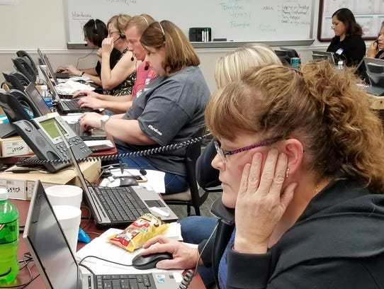 Volunteers at Abilene's 2-1-1 A Call For Help fielded