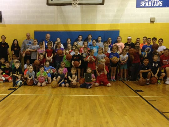 Rachelle Matthys (far left) smiles with the participants of her last skills camp at St. Mary's School.