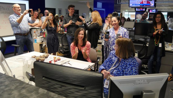 The newsroom of The Arizona Republic and azcentral.com celebrate the Pulitzer Prize announcement on April 16, 2018.