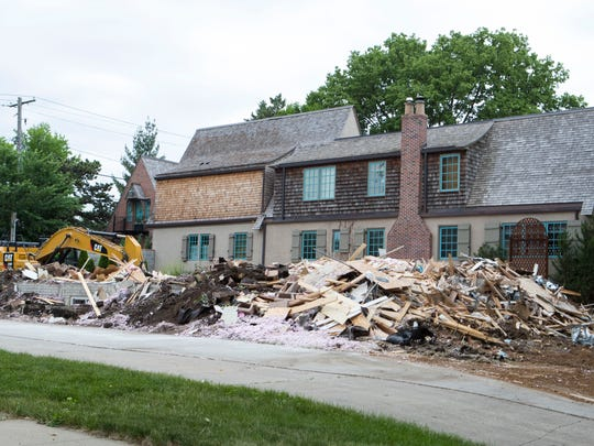 The Sapienza home is torn down Thursday, June 7, 2018 in Sioux Falls, S.D.