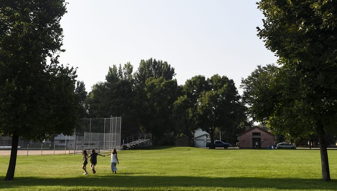 In this Coloradoan library photo, children walk hand in hand near the playground on the first day of school at Beattie Elementary School, Monday, Aug. 24, 2015, in Fort Collins, Colo.On Sunday, Aug. 21, 2016, a citizen found a loaded handgun on Beattie's lawn.