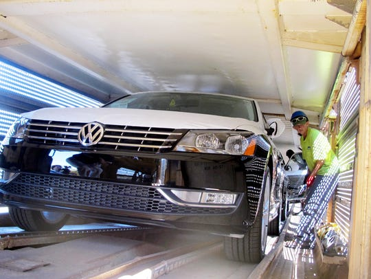 Workers at the Volkswagen plant in Chattanooga load cars on a train to be shipped to dealerships. The automaker's announcement of a $340 million investment to build the Atlas SUV was the largest made by a foreign company in Tennessee in 2018, according to a new MTSU report.