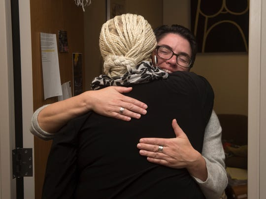 Christine Kroger, a San Joaquin County public defender, gets a hug from Marcella White, 68, of Oakland, in November. Kroger helped White get a prior felony reduced to a misdemeanor earlier this year.