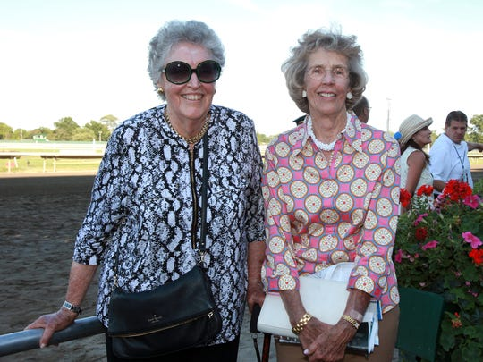 Isabelle de Tomaso (L) and her sister, Hope Haskell Jones, the daughters of Monmouth Park founder Amory Haskell, at the 2015 Haskell Invitational at Monmouth Park.