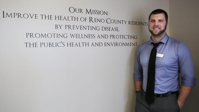 Reno County Health Department director Nick Baldetti poses for a portrait next to the department's mission statement in this file photo. Baldetti has resigned his post to take a job at McPherson College.