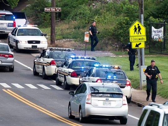 Knoxville Police Department and Tennessee Highway Patrol cars parked along Hollywood Road near Pond Gap Elementary in Knoxville on Monday, July 2, 2018.