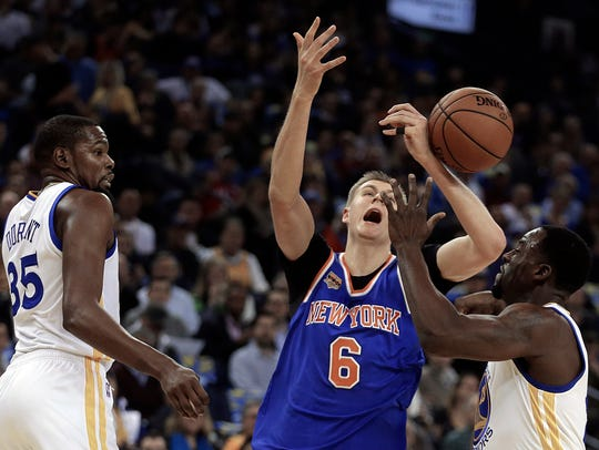 The Knicks' Kristaps Porzingis loses the ball against
