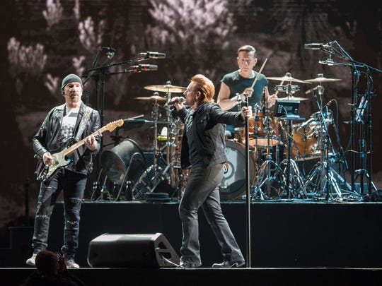 U2 members (from left) The Edge, Bono and Larry Mullen Jr. perform.