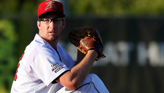 Volcanoes pitcher Grant Watson winds up to throw against Eugene at Volcanoes Stadium, Thursday, August 20, 2015, in Keizer, Ore.
