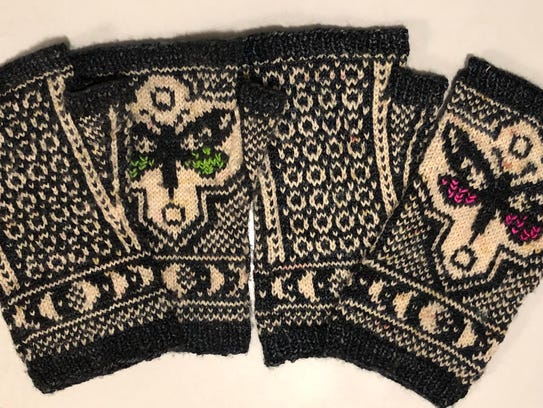Underwing Mitts by Erica Heusser that Ency Austin knitted.