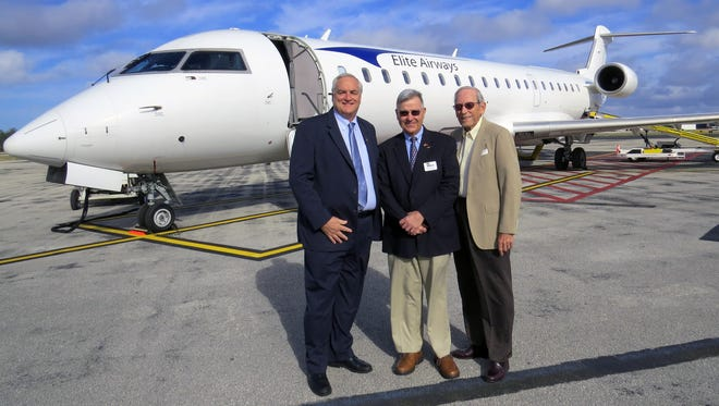 From left: John Pearsall, president of Elite Airways; Ted Soliday, executive director of the Naples Airport Authority; and Jim Rideoutte, airport commissioner in front of an Elite Airways Bombardier CRJ.