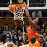 Syracuse Orange forward Tyler Roberson (21) dunks against the Duke Blue Devils in their game at Cameron Indoor Stadium.