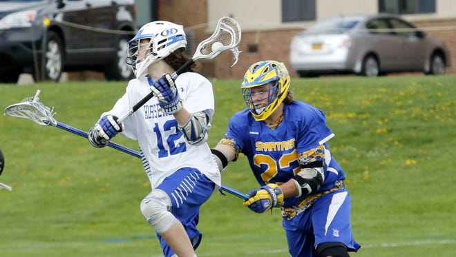 Jacob Giammichele of Horseheads takes a shot as Alex Knight of Maine-Endwell defends Tuesday during their Section 4 game at Horseheads High School.