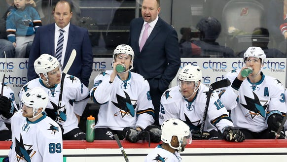 San Jose Sharks head coach Peter DeBoer, standing right,