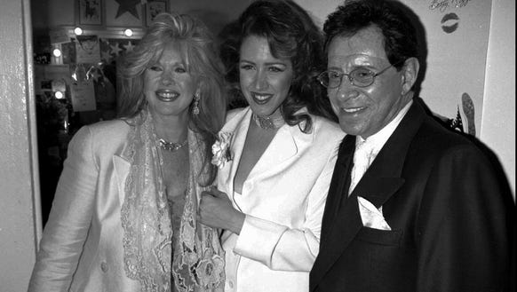 Joely Fisher, center, poses with her famous parents,