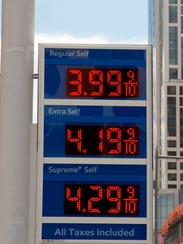 FILE- In this April 18, 2018, file photo, gas prices