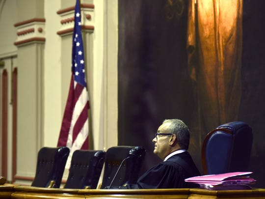 Muskingum County Common Pleas Judge Kelly Cottrill listens to a heroin addict plead her case in court on Monday, July 10, in Zanesville, Ohio. Of the seven people who came before the court, three were heroin-related.