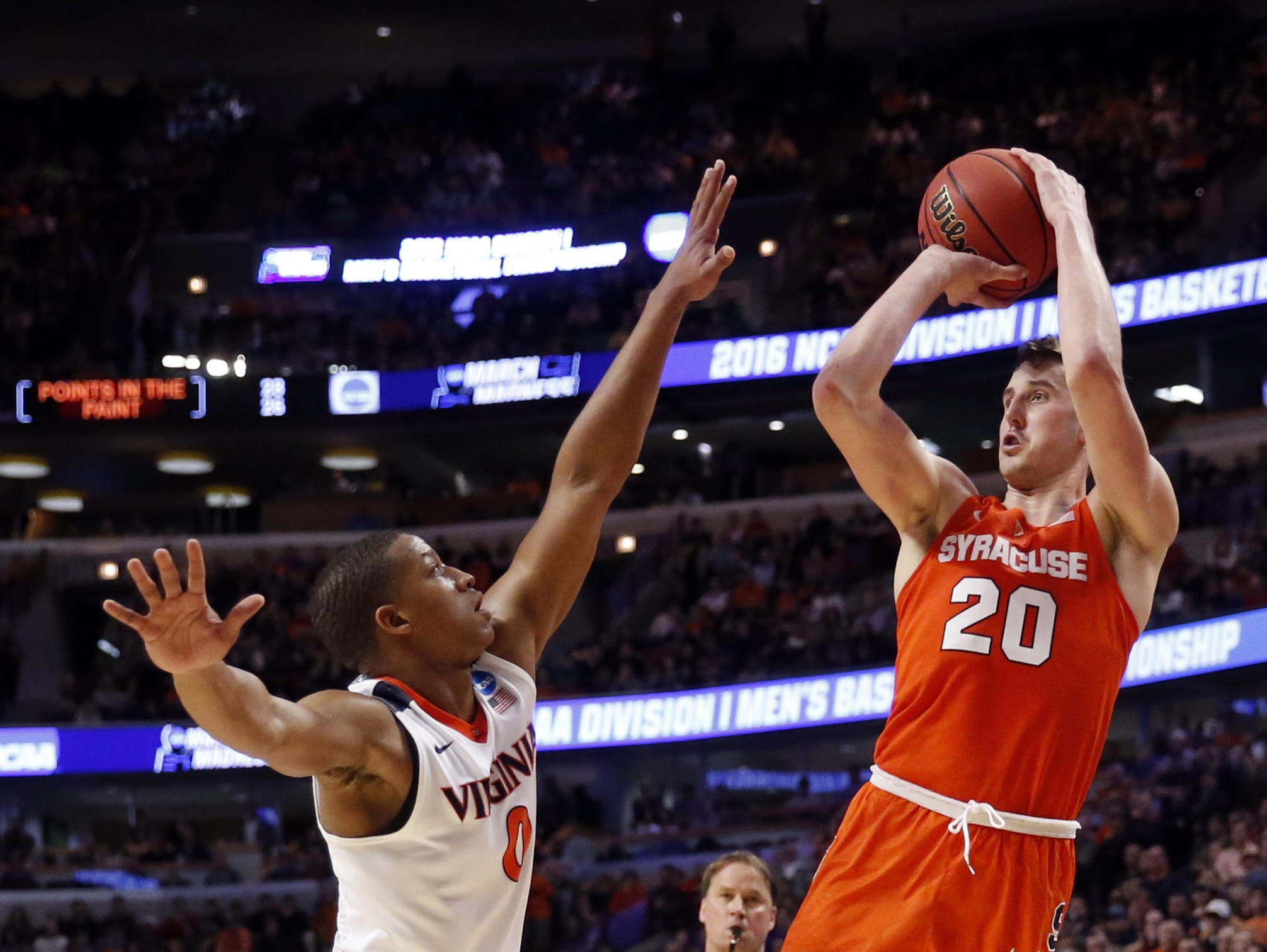 Syracuse's Tyler Lydon, an Elizaville native, shoots over Virginia's Devon Hall during the NCAA tournament Midwest regional final on Sunday in Chicago.