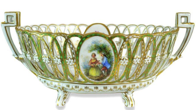 This floral center signed Dresden bowl features German porcelain, hand painted flowers, gold accents and Renaissance era romance panels. It recently sold at auction for $92.