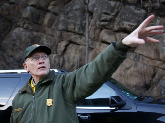 Clay Jordan, deputy superintendent at the Great Smoky Mountains National Park, points to the site of the Chimney Tops 2 fire.