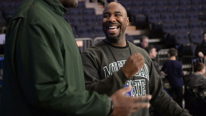 Former Michigan State basketball player Mateen Cleaves watches practice March 27, 2014, in New York.