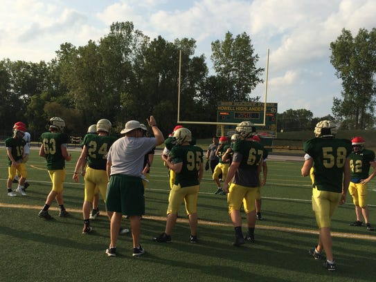 Coach Aaron Metz instructs players during practice