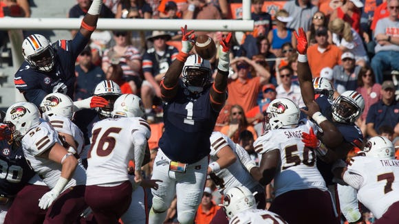 Auburn Tigers defensive tackle Montravius Adams (1) blocks a field goal attempted by Louisiana Monroe Warhawks place kicker Craig Ford (16) during the Auburn vs. ULM NCAA football game on Saturday, Oct. 1, 2016, in Auburn, Ala.